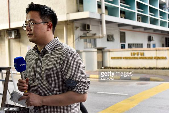 Korean YTN news reporter handles a YTN news report about Kim Jongnam's a murder case at outside of Kuala Lumpur hospital on February 19 2017 at Kuala...