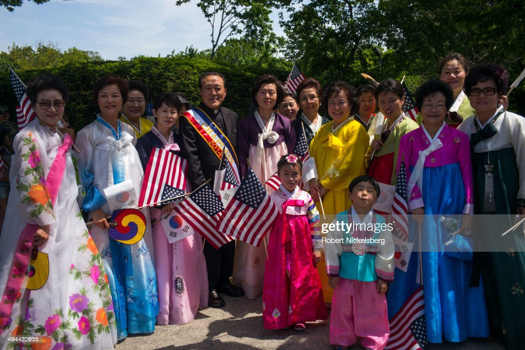 Korean-American members of the Korean Evangelical Church pose for a picture May 26, 2014 at the start of the 96th Staten Island Memorial Day parade in Staten Island, New York. Memorial Day was originally celebrated as Decoration Day after the Civil War in 1868. It became a federal holiday in 1971 and commemorates all those who have died fighting for the U.S. in wars.