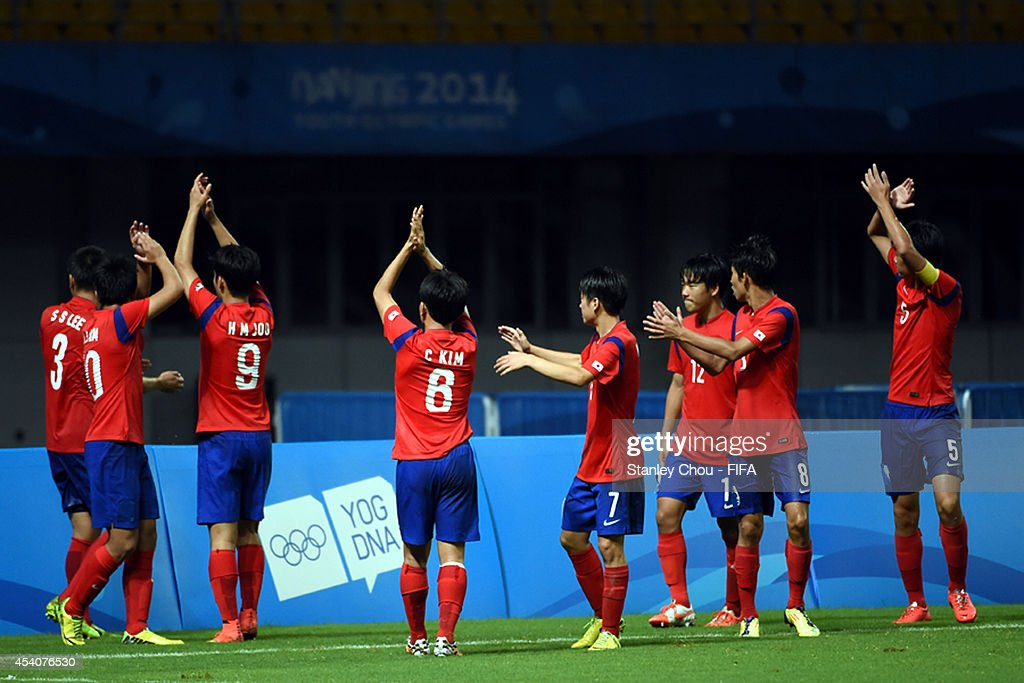 Koreans celebrate after beating Iceland 3-1 in the penalty shoot out after full time 1-1 draw during the 2014 FIFA Boys Summer Youth Olympic Football Tournament Semi Final match between Korea Republic and Iceland at Jiangning Sports Centre Stadium on August 24, 2014 in Nanjing, China.