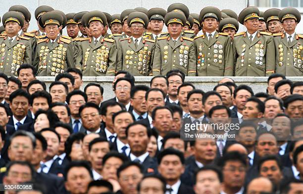 Koreans in business suits and military outfits attend a parade at Kim Il Sung Square in Pyongyang North Korea on May 10 2016 The parade and...