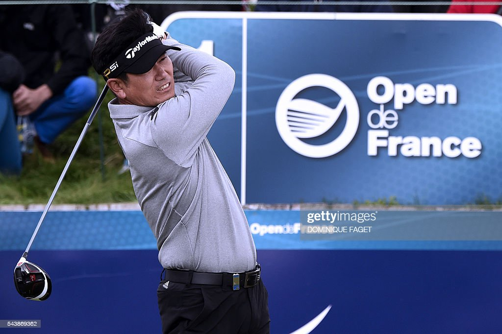 Korean's Y.E. Yang plays off the 1st tee during the first round of the 100th French Golf Open on July 30, 2016 at Le Golf National in Guyancourt, near Paris. / AFP / DOMINIQUE