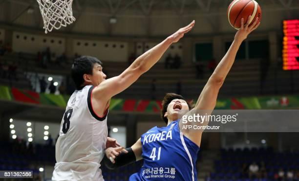 Korea's center Oh Sekeun attempts to score on Japan's center Ota Atsuya during their 2017 FIBA Asia Cup quarterfinal basketball match in the Lebanese...