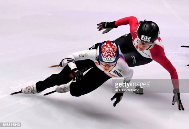 Korea's Choi Minjeong and Canada's Jamie MacDonald compete during the final competition in the 'Women 3000m Relay' category at the ISU World Cup...