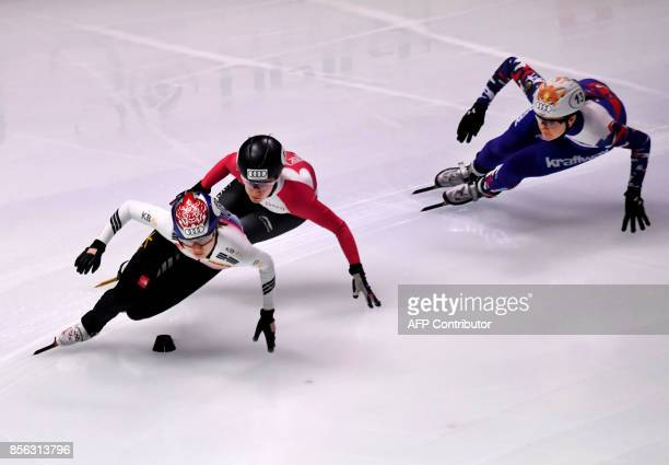 Korea's Choi Minjeong Canada's Jamie MacDonald and Russia's Sofia Prosvirnova compete during the final competition in the 'Women 3000m Relay'...
