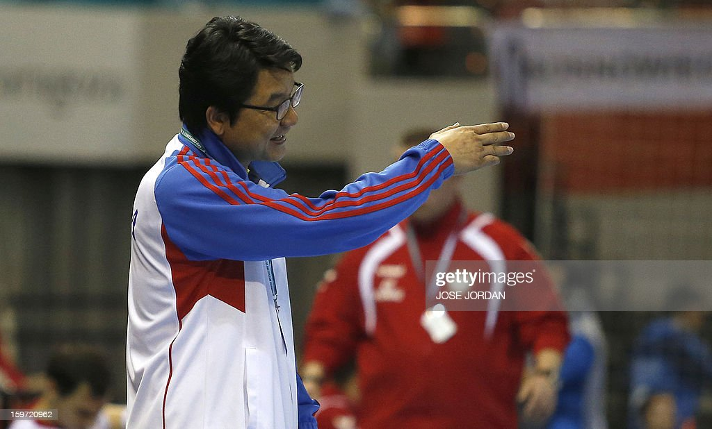 Korea's coach Lee Sang-Sup reacts during the 23rd Men's Handball World Championships preliminary round Group C match Poland vs South Korea at the Pabellon Principe Felipe in Zaragoza on January 19, 2013. AFP PHOTO/ JOSE JORDAN