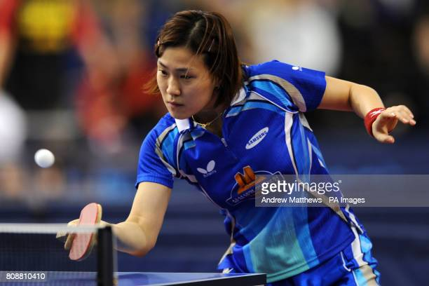 Korea's Hyun Jung Moon in action against Japan's Misaki Morizono during their Women's Singles first round match