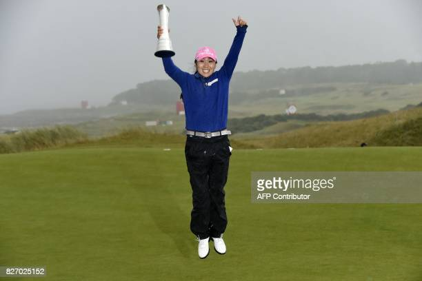 Korea's InKyung Kim celebrates with the trophy after her victory in the 2017 Women's British Open Golf Championship at Kingsbarns Golf Links near St...