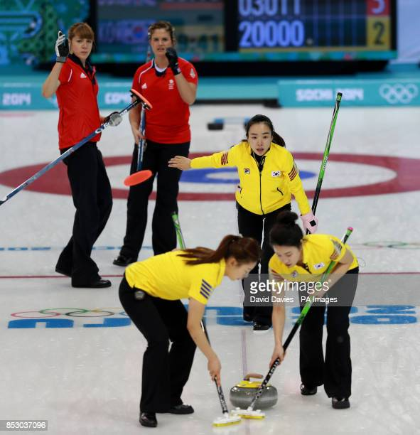 Korea's Jisun Kim directs her team mates as Great Britain's Vicki Adams and Claire Hamilton watch on during their Curling Round Robin match at the...