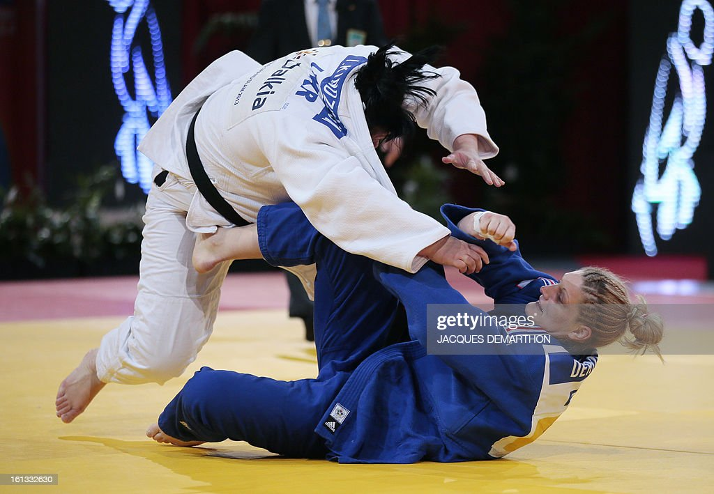 Korea's Kim Eun-Gyeong (white) fights against France's Marjorie Deroose (blue) on February 10, 2013 in Paris, during the eliminatories of the Women + 78kg of the Paris Judo Grand Slam tournament.