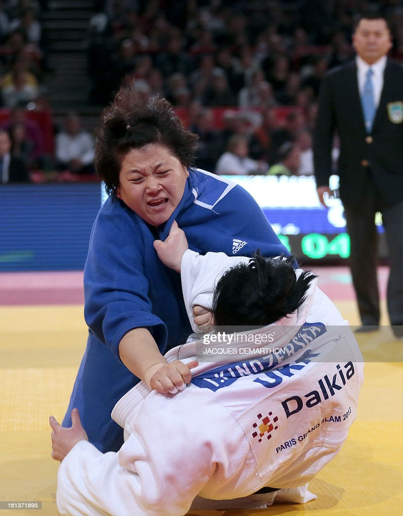 Korea's Kim Jiyoun (blue) competes with Ukraine's Iryna Kindzerska (white) on february 10, 2013 in Paris, during the Bronze medal fight of the Women's +78kg category of the Paris Judo Grand Slam tournament, at the Palais Omnisports de Paris-Bercy (POPB) in Paris, on February 10, 2013.