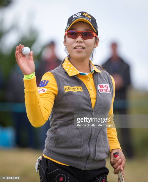 Korea's Mi Hyang Lee acknowledges the fans on the 18th green following a birdie during day four of the Aberdeen Asset Management Ladies Scottish Open...