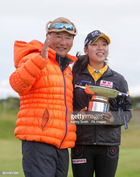 Korea's Mi Hyang Lee poses with the trophy and her father following her 1 stroke win during day four of the Aberdeen Asset Management Ladies Scottish...