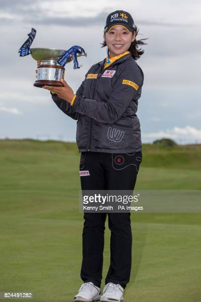 Korea's Mi Hyang Lee poses with the trophy following her 1 stroke win during day four of the Aberdeen Asset Management Ladies Scottish Open at...