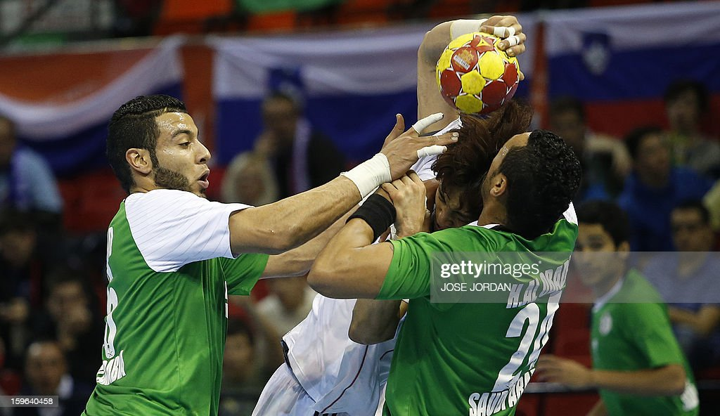 Korea's pivot Park Chan-Yong (C) vies with Saudi Arabia's right back Abdullah Alhammad (L) and Saudi Arabia's right back Hisham Alobaidi (R) during the 23rd Men's Handball World Championships preliminary round Group C match Saudi Arabia vs South Korea at the Pabellon Principe Felipe in Zaragoza on January 17, 2013.
