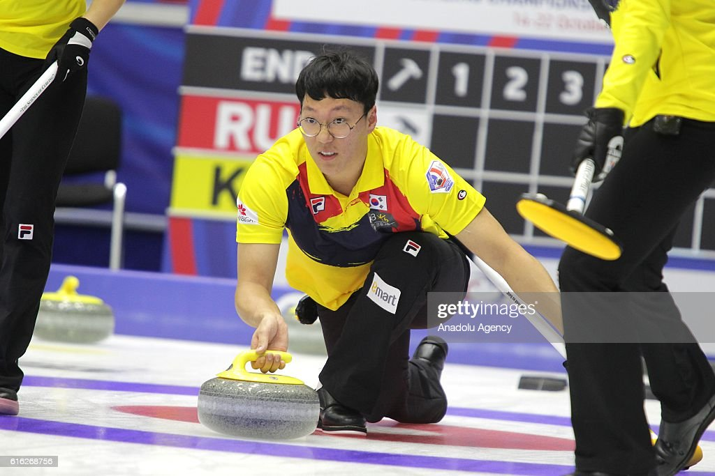 Korea's second Seong Yujin delivers a stone during semi-finals the game between Russia and Korea within the World Mixed Curling Championship 2016 at the Sport Palace in Kazan, Russia on October 22, 2016.