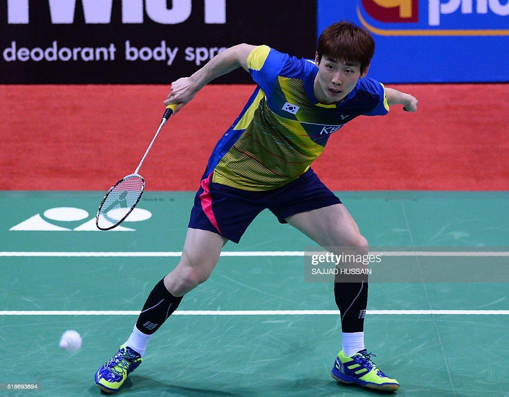 Korea s Son Wan Ho plays a shot during his men s singles semi