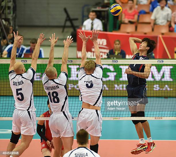 Korea's Song Myunggen attacks against Antti Siltala Jukka Lehtonen Mikko Esko during the FIVB World Championships match between Finland v Korea on...