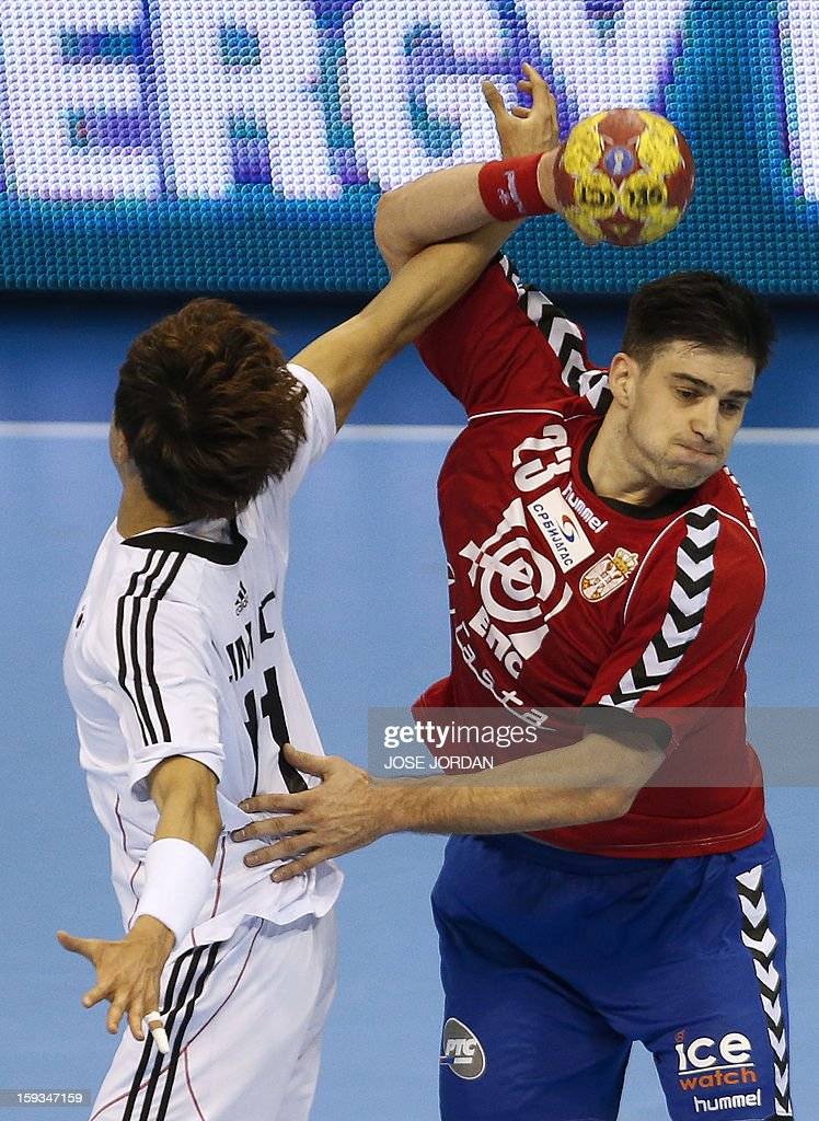 Korea's wing Duk-Jun Lim (L) vies with Serbia's back Nenad Vuckovic during the 23rd Men's Handball World Championships preliminary round Group C match Serbia vs Korea at the Pabellon Principe Felipe in Zaragoza on January 12, 2013.