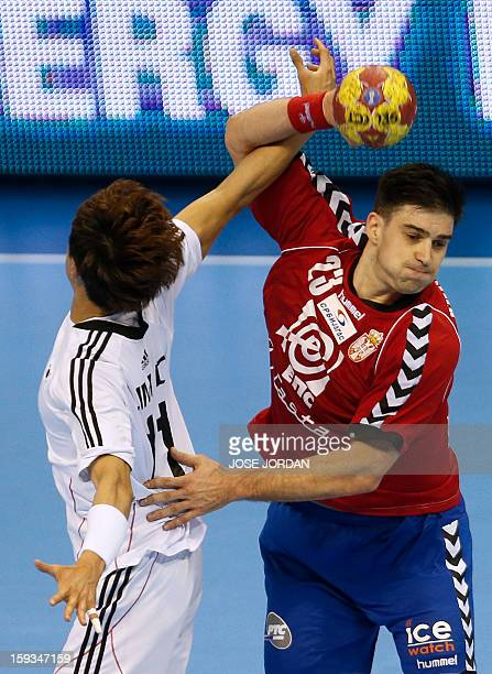 Korea's wing DukJun Lim vies with Serbia's back Nenad Vuckovic during the 23rd Men's Handball World Championships preliminary round Group C match...
