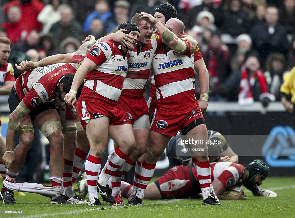 Koree Britton of Gloucester (C) celebrates with team mates after Referee Luke Pearce awards Gloucester a penalty try during the Aviva Premiership match between Gloucester and Sale Sharks at the Kingsholm Stadium on November 24, 2012 in Gloucester, England.