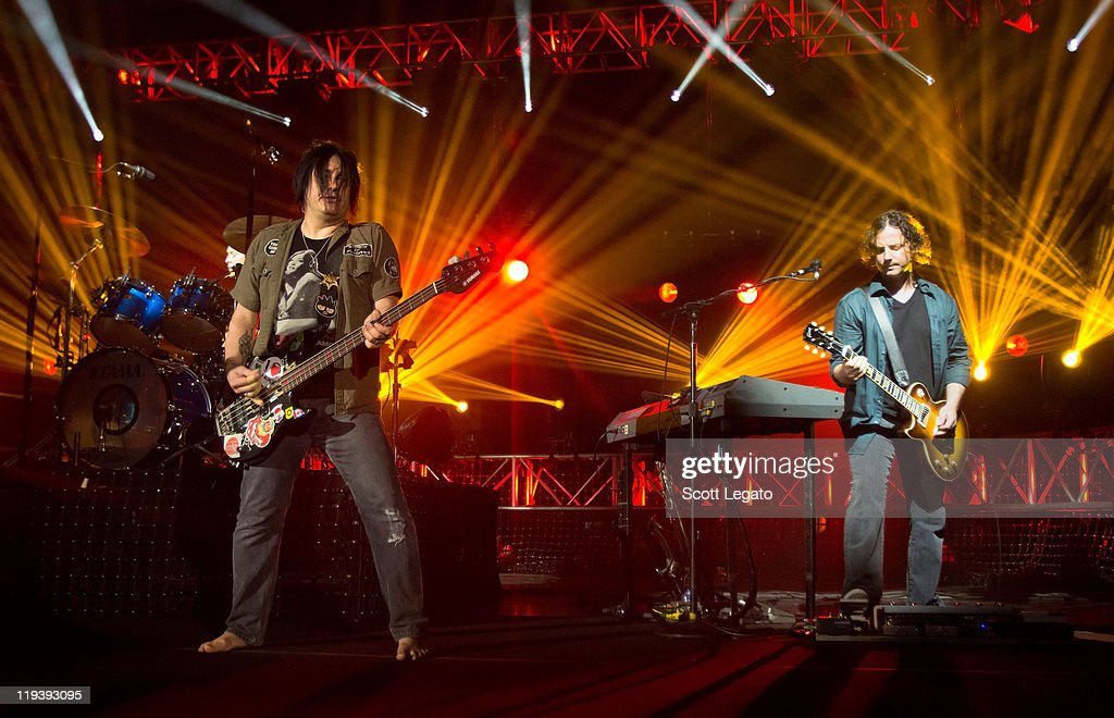 Korel Tunador and Robby Takac of The Goo Goo Dolls performs at the Meadow Brook Music Festival on July 17, 2011 in Rochester, Michigan.