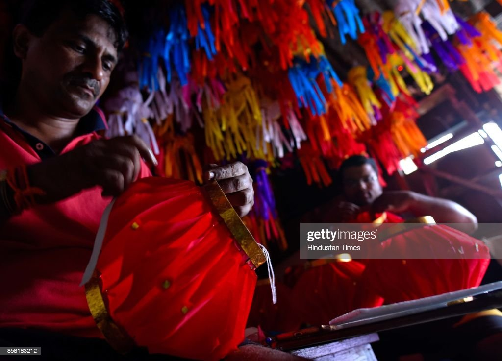 Korey family members prepare around 600 'Aakash Kandil' made of paper and cane for upcoming Diwali Festival at Matunga, on October 5, 2017 in Mumbai, India.