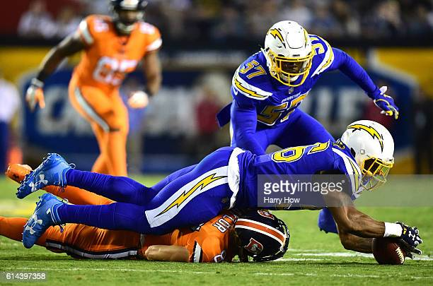 Korey Toomer of the San Diego Chargers recovers a fumble stripping Jordan Taylor of the Denver Broncos of the ball during the third quarter at...
