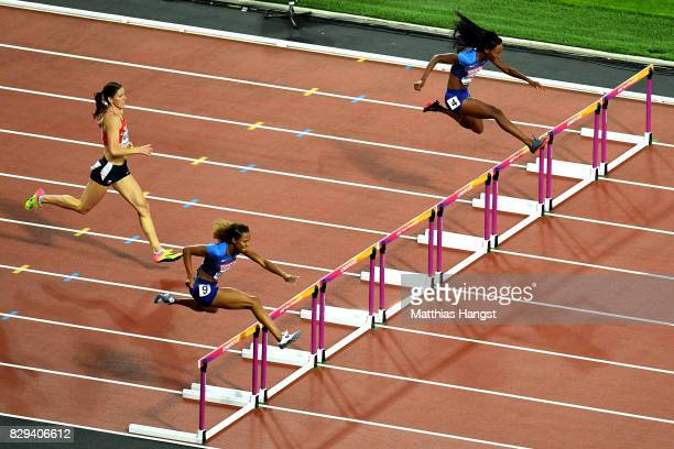 Kori Carter and Dalilah Muhammad of the United States clear a hurdle during the womens 400 metres hurdles final during day seven of the 16th IAAF...