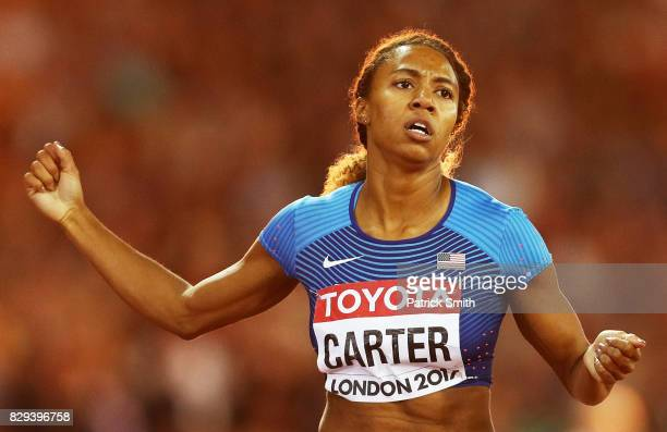 Kori Carter of the United States celebrates as she crosses the line to win the womens 400 metre hurdles final during day seven of the 16th IAAF World...