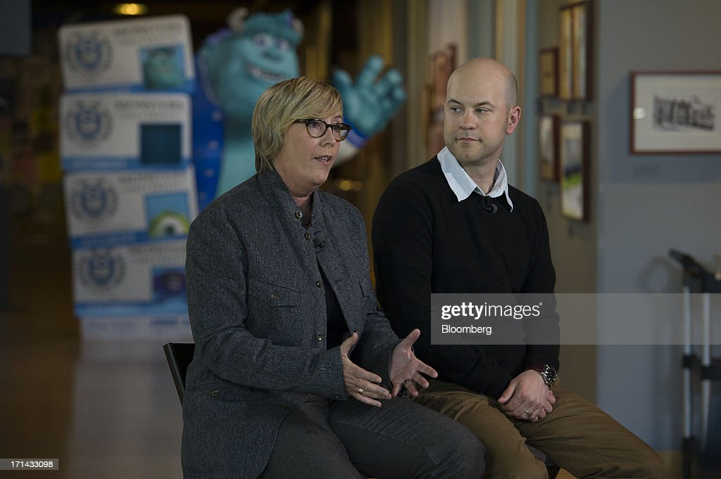 Kori Rae, producer of the Pixar movie 'Monsters University', left, speaks Dan Scanlon, director of the Pixar movie 'Monsters University', while listens during a Bloomberg West Television interview at the Pixar Animation Studios headquarters in Emeryville, California, U.S., on Friday, June 21, 2013. Walt Disney Co.s Pixar animation 'Monsters University' took first place at U.S. and Canadian theaters this past weekend with $82 million in ticket sales, overcoming Brad Pitts zombie apocalypse tale 'World War Z,' which was second with $66 million. Photographer: David Paul Morris/Bloomberg via Getty Images