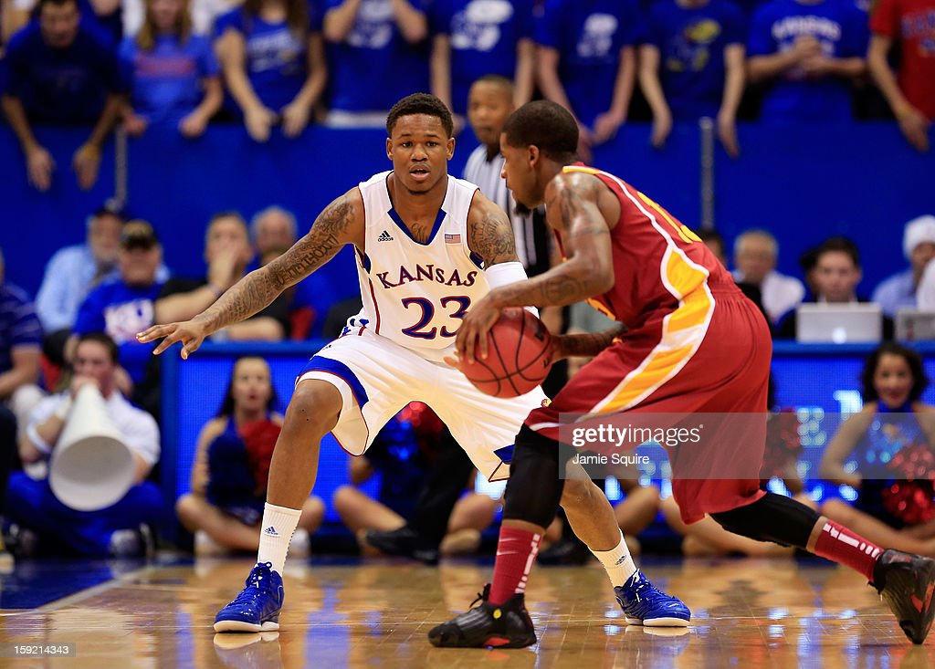 Korie Lucious #13 of the Iowa State Cyclones controls the ball as Ben McLemore #23 of the Kansas Jayhawks defends during the game at Allen Fieldhouse on January 9, 2013 in Lawrence, Kansas.