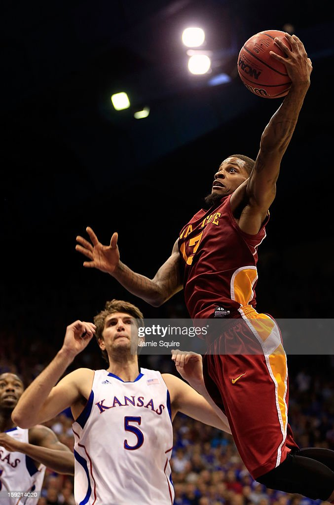 Korie Lucious #13 of the Iowa State Cyclones shoots over Jeff Withey #5 of the Kansas Jayhawks during the game at Allen Fieldhouse on January 9, 2013 in Lawrence, Kansas.