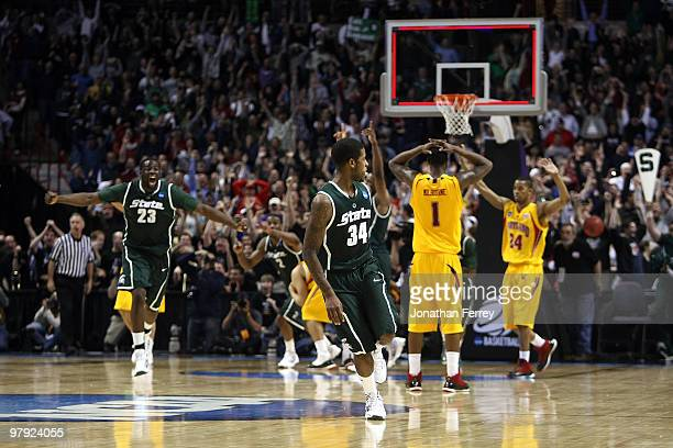 Korie Lucious of the Michigan State Spartans runs down the court after sinking a game winning three point shot at the buzzer to win 8583 against the...