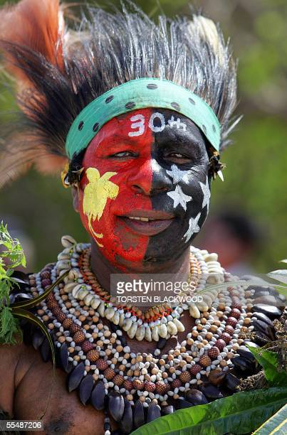 Koriki elder Steven Ipai sports a birdofparadise and the Southern Cross on his face while watching the Hiri Moale festival in Port Moresby 15...