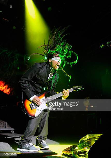 Korn guitarist James 'Munky' Shaffer performs during the Music as a Weapon 5 tour at The Joint inside the Hard Rock Hotel Casino March 12 2011 in Las...