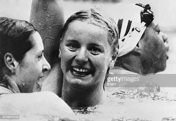Kornelia Ender from East Germany celebrates after winning the final of the 200m freestyle in front of Shirley Babashoff from the United States and...