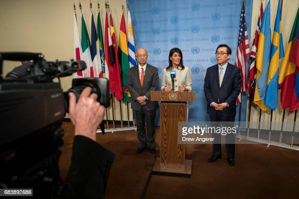 Koro Bessho Japanese ambassador to the United Nations Nikki Haley US ambassador to the United Nations and Cho Taeyul South Korean Ambassador to the...