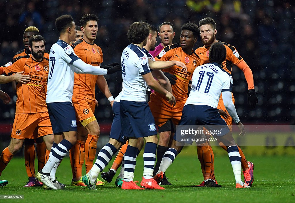 Kortney Hause of Wolverhampton Wanderers squares up to Ben Pearson of Preston North End during the Sky Bet Championship match between Preston North End and Wolverhampton Wanderers at Deepdale on November 19, 2016 in Preston, England.