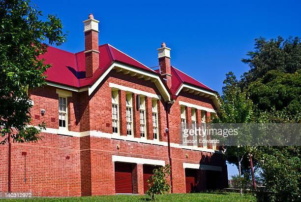 Large chimneys and red brick facade of the Korumburra Primary School.