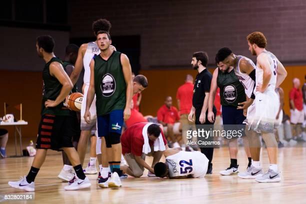 Kory Jones of the Arizona Wildcats lays injured in the ground during the Arizona In Espana Foreign Tour game between Mataro AllStars and Arizona on...