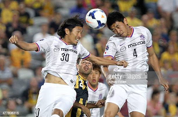 Kosei Shibasaki and Hiroki Mizumoto of Sanfrecce Hiroshima head the ball during the AFC Asian Champions League match between the Central Coast...