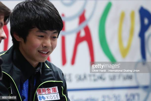 Koshiro Shimada of Japan look on at the kiss and cry in the Junior Men Short Program during day two of the ISU Junior Grand Prix of Figure Skating at...