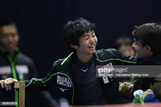 Koshiro Shimada of Japan look on at the kiss and cry in the Junior Men Free Skating Program during day three of the ISU Junior Grand Prix of Figure...