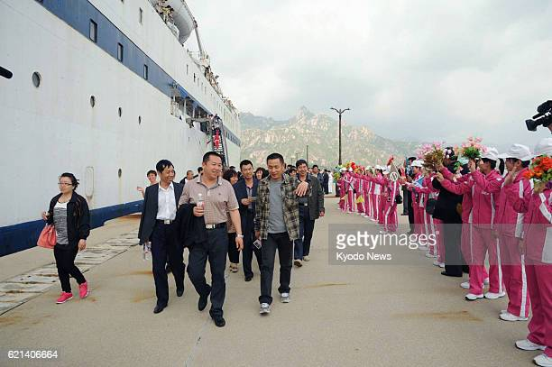Kosong North Korea Chinese and other foreign tourists arrive at Kosong port in Kangwon Province North Korea on May 20 aboard the Singaporean cruise...
