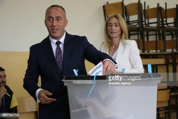 Kosovan Prime Minister candidate Ramush Haradinaj casts his vote at a polling station during a snap parliamentary contest after the government in...