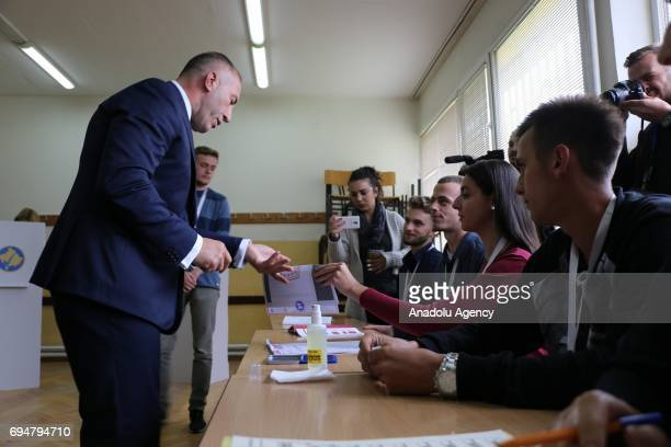 Kosovan Prime Minister candidate Ramush Haradinaj prepares to cast his vote at a polling station during a snap parliamentary contest after the...