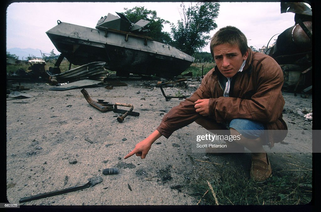 Kosovar Bardhyl Kamberi August 281999 points to a spent bullet casing from 30mm depleted uranium rounds used by American aircraft in Djakovica Kosovo...