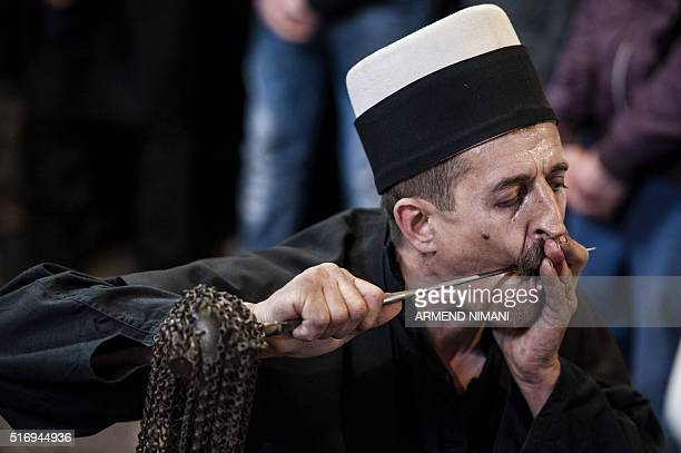 A Kosovar dervish pierces his cheek with a metal rod during a ceremony marking Newroz celebrations on March 22 2016 at a prayer room in the town of...