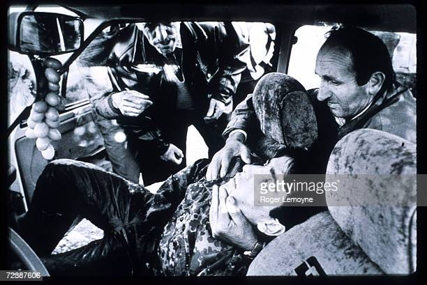 Kosovar Liberation Army fighter dies enroute to the hospital after being wounded while defusing Serb land mines October 1998 in Kosovo Yugoslavia...