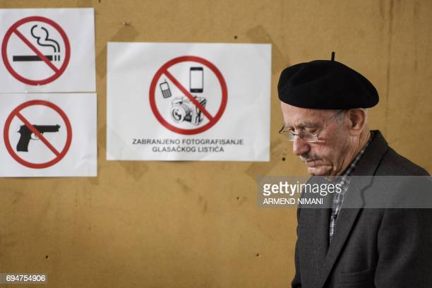 Kosovar man arrives to vote at a polling station in Pristina during early parliamentary elections in Kosovo on June 11 2017 Kosovo began voting for a...